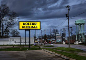store sign for Dollar General on a road in town