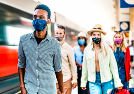 photo of people wearing masks in an airport